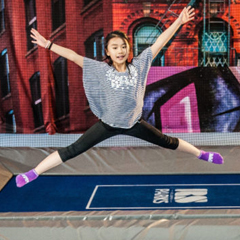 Young female plays ValoJump trampoline game