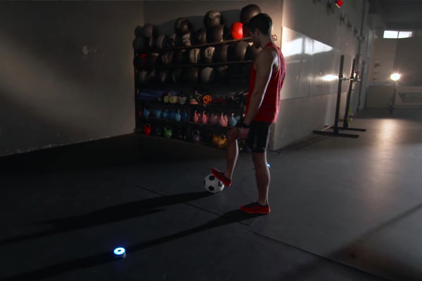 Man training soccer football drill using BlazePod wireless modules
