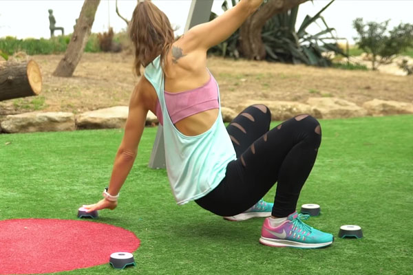 Woman trains outdoors with BlazePods fitness technology